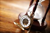 stock photo of sand timer  - Hour glass or sand timer with vintage pocket watch - JPG