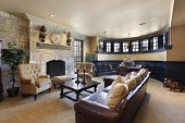 stock photo of basement  - Basement in luxury home with stone fireplace - JPG