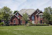 picture of front door  - Large brick home with large window above front door - JPG
