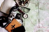Wanderlust And Adventure Concept, Compass Camera Phone Passport Money Notebook  On Map, Top View, Sp poster