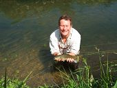 picture of mayfly  - Fly fisherman with a good catch of a healthy brown trout on an English chalkstream - JPG