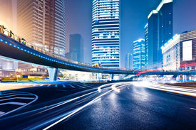 image of modern building  - the light trails on the modern building background in shanghai china - JPG