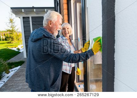 Modern Retired Couple Smiling Broadly