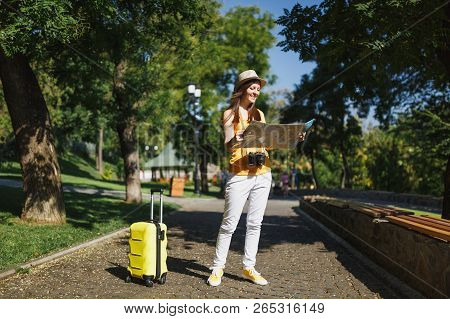 poster of Young Joyful Traveler Tourist Woman In Yellow Summer Casual Clothes, Hat With Suitcase City Map Walk