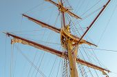 Mast Sailing Ship, With Raised Sails Against The Clear Sky In Calm Weather. poster