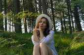 Portrait Of  Beautiful Woman Relaxing In Nature. Beautiful Woman Relaxing In Nature. Healthy Lifesty poster