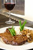 foto of ribeye steak  - Cooked Ribeye meal rice green beans and mushrooms close up with red wine out of focus  - JPG