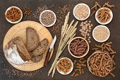 High fibre natural health food with whole wheat pasta, whole grain rye bread, oatmeal, oats, bran fl poster