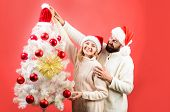 Stylish Christmas Couple Decorating Fir-tree. Winter Holiday And New Year. Happy Family Celebrate Ne poster