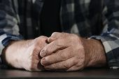 Poor Elderly Man Sitting At Table, Focus On Hands poster