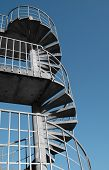 image of spiral staircase  - metal and concrete fire escape on the side of a building - JPG