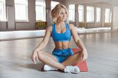 Strong Sexy Athletic Young Woman Working Out In Gym poster