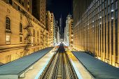 Adams Wabash Train Line Towards Chicago Loop In Chicago By Night poster
