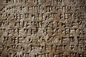 foto of mesopotamia  - Ancient Sumerian cuneiform writing engraved in a stone - JPG