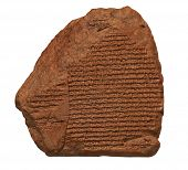 stock photo of babylonia  - Clay tablet with cuneiform writing of the ancient Sumerian  or Assyrian civilization isolated on white with clipping path - JPG