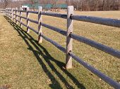 picture of split rail fence  - An abstract view of a split rail wood fence by a field - JPG