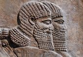 stock photo of sumerian  - Detail of an ancient relief of two assyrian warriors - JPG