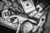 picture of workbench  - Set of tools over a wood panel on black and white - JPG