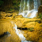 Waterfall and river flowing among rocks in the cuban natural landmark of Soroa poster