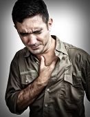 stock photo of tragic  - Grunge image of a man having a chest pain or heart attack - JPG