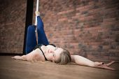 Girl Lie On The Floor Near A Pylon Posing In A Pole Dance Studio poster