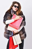 Buy With Discount On Black Friday. Shopping With Promo Code. Girl Wear Sunglasses And Fur Coat Shopp poster