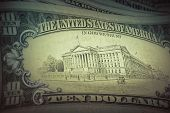 Money background - US dollars background, retro style toned photo with shallow DOF