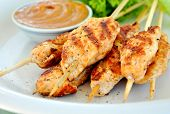 pic of butter-lettuce  - Grilled chicken skewers on a plate with peanut butter sauce and green salad on the side - JPG