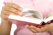stock photo of girl reading book  - Close - JPG