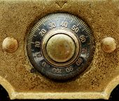 Early 1900s dial combination lock close up. Black dail and gold plate.