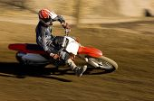 stock photo of motocross  - Motocross Racer racing - JPG