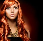Portrait of a Beautiful Girl With Healthy Long Red Hair. Wavy Hair.Hairdressing.Hairstyle