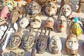 stock photo of cultural artifacts  - African masks on the traditional market - JPG