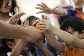 image of lineup  - Humanitarian food for poor children in refugee camp - JPG