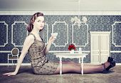 picture of fable  - beautiful woman in little room drink a cup of tea  - JPG