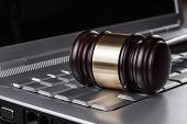 stock photo of judiciary  - judge gavel on computer cyber crime concept - JPG