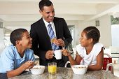 foto of 11 year old  - Father Having Breakfast With Children Before Work - JPG
