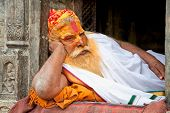 KATHMANDU, NEPAL - MAY 18: Shaiva sadhu seeks alms on the Pashupatinath Temple  on May 18, 2013 in K