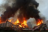 image of tragic  - flames and smoke rise from burning building - JPG