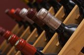 stock photo of wine bottle  - Rows of Diagnal Wine Bottles in a Rack - JPG
