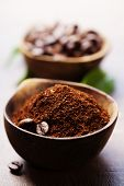 stock photo of coffee grounds  - Wooden Bowls with coffee beans and ground coffee - JPG