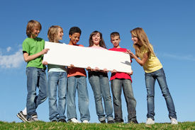 image of children group  - group of happy smiling diverse kids holding blank sign - JPG