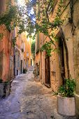 Narrow alley in Saint Tropez at C�?�´te d'Azur, France