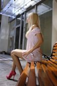 foto of school-leaver  - Beautiful blonde woman on a bench is waiting job interview - JPG