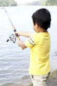 Asian boy fishing