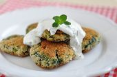 stock photo of veggie burger  - Delicious veggie burger patty with chard and a sour cream dip - JPG
