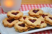 foto of augen  - Traditional home made Linzer Cookies filled with jam - JPG
