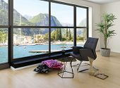 Modern loft interior with black chair against huge window with lakeside view