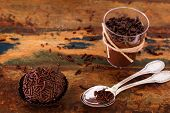pic of bonbon  - Brazilian chocolate bonbon truffle brigadeiro with spoon on wooden table - JPG