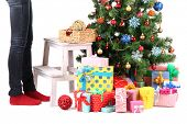 pic of bow-legged  - Female legs on wooden ladder near Christmas tree and gifts isolated on white - JPG
